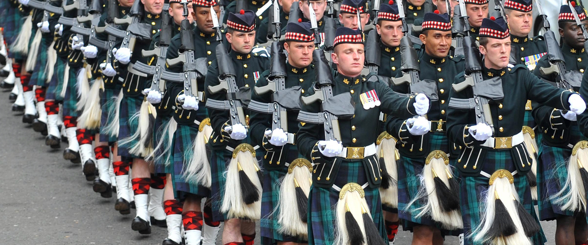 Soldiers march in kilts